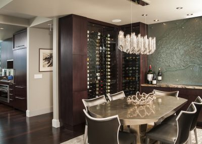 Glass and Steel meet Warmth and Wine Dining Room